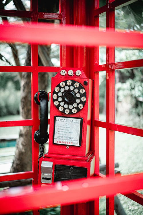 Shallow Focus Photo Of Red Rotary Telephone