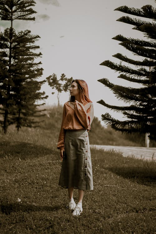 Woman In Long Sleeved Shirt And Skirt