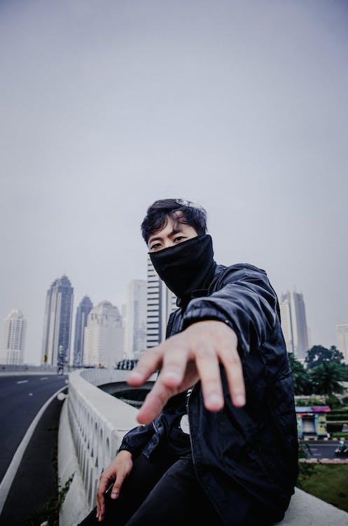 Photo of Man Wearing Black Scarf