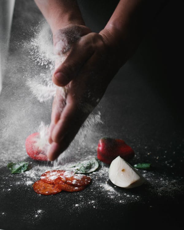 Person Pouring Flour