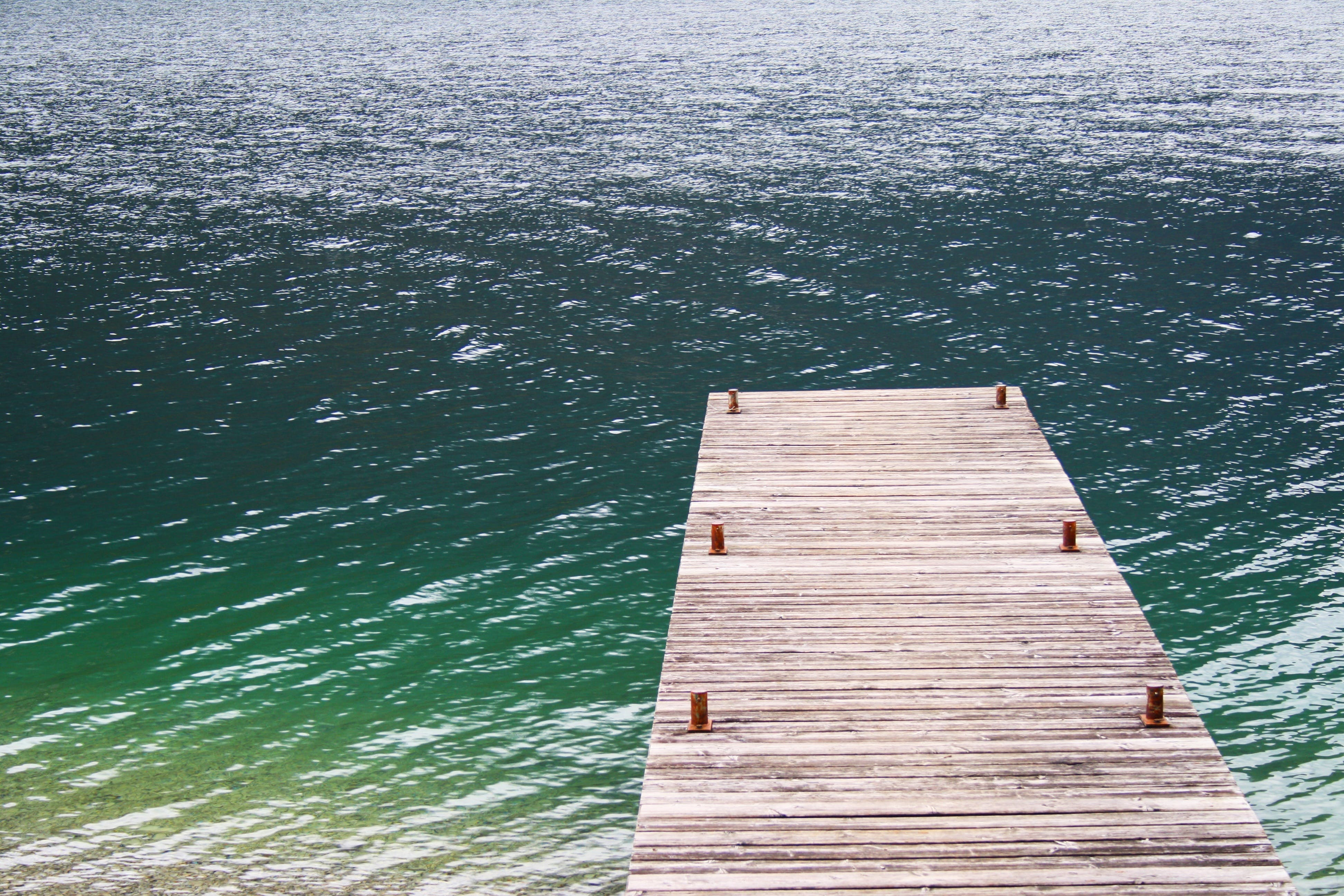 Brown Wooden Dock on Side of Body of Water