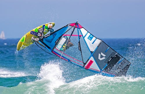 Photo of Person Doing Windsurfing