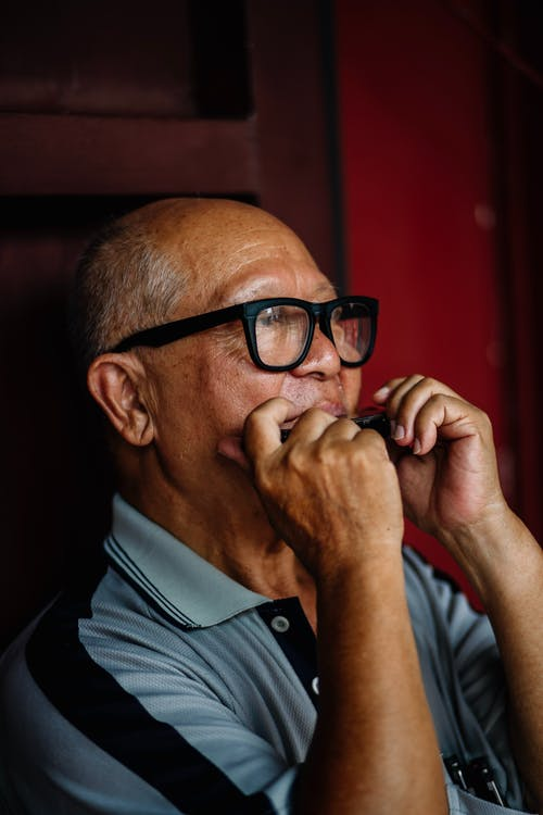 Photo Of Old Man Wearing Black Eyeglasses