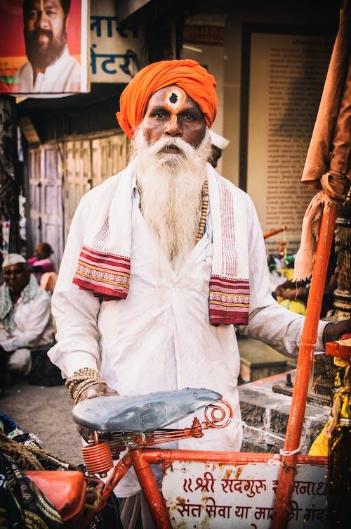 Man Wearing Orange Turban
