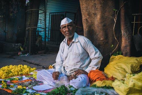 Kostenloses Stock Foto zu blumen, blumenhändler, erwachsener, festival von indien