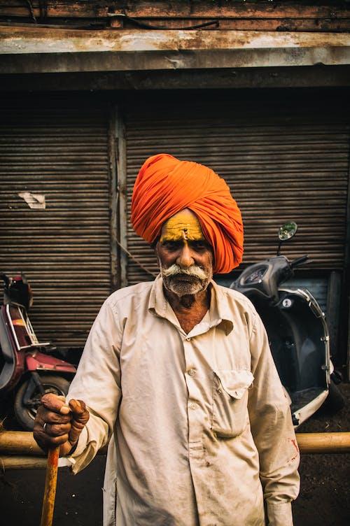 Shallow Focus Photo Of Man Wearing Orange Turban Headdress