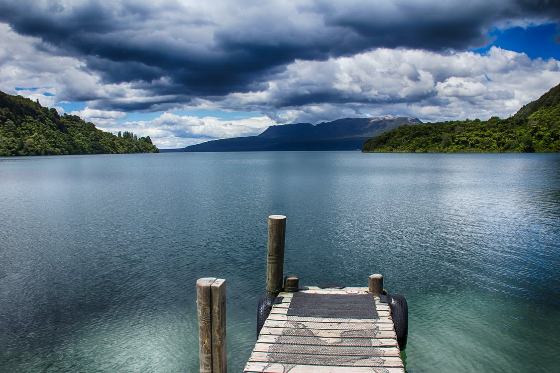 Brown Wooden Dock on Body of Water