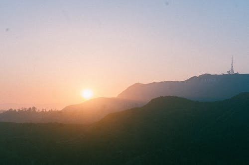 Scenic View Of Mountains During Dawn