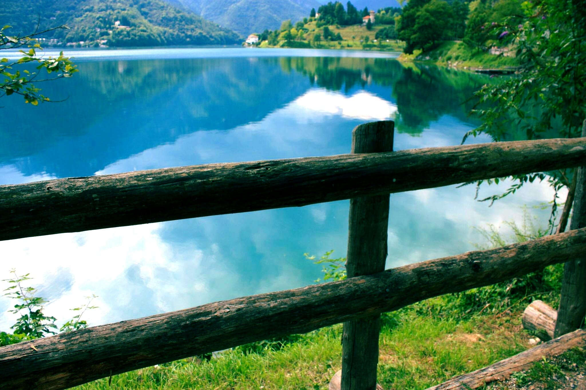 Green Wooden Fence Beside Body of Water