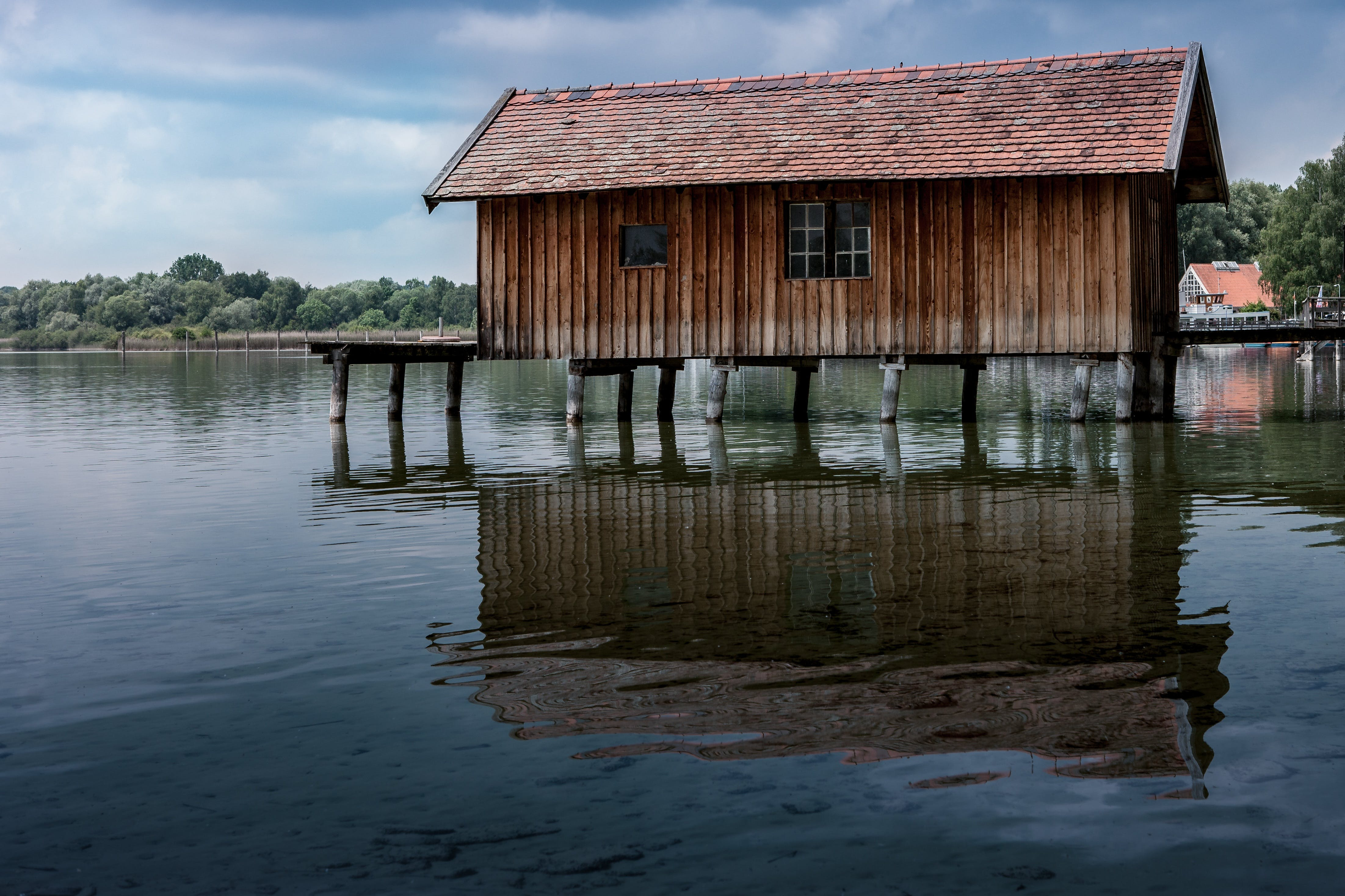 Brown Wooden House on River