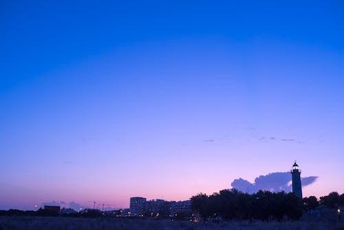 Бесплатное стоковое фото с береговая линия, голубое небо, маяк, ночное небо