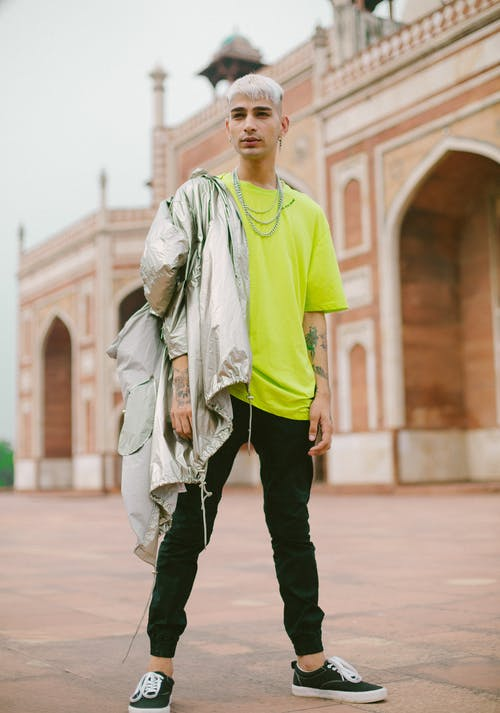 Photo of Man Wearing Neon Green Shirt