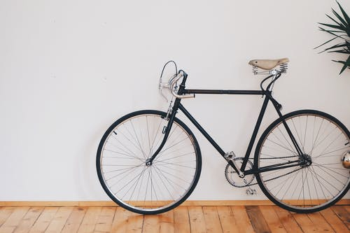 Black Fixed-gear Bike Beside Wall