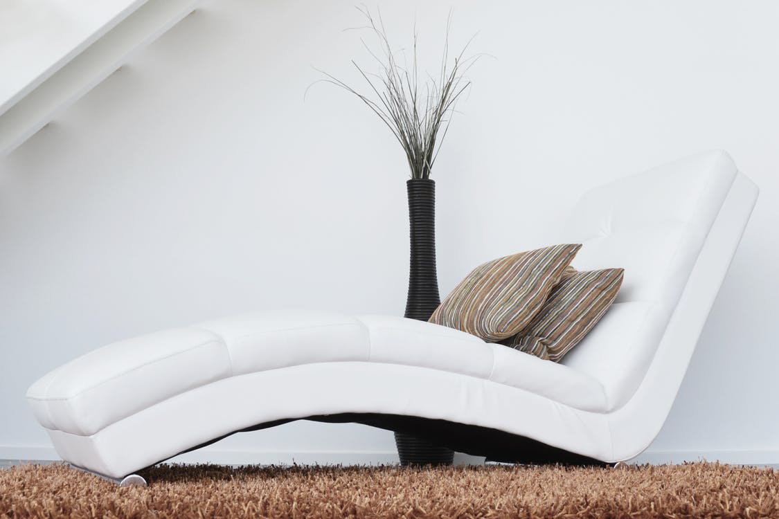 Two Pillows on White Leather Fainting Couch