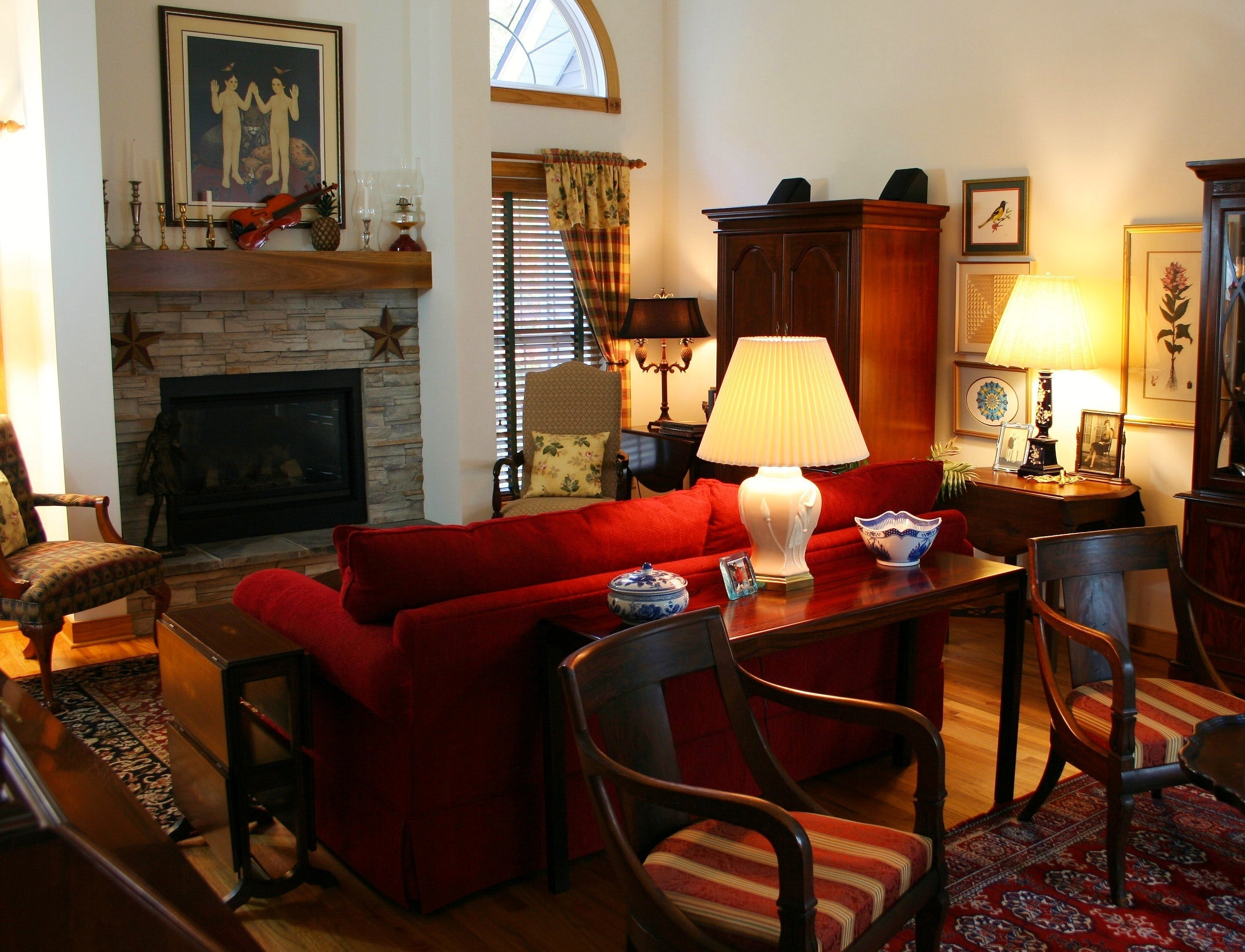 Brown Wooden Console Table Next to Red Loveseat