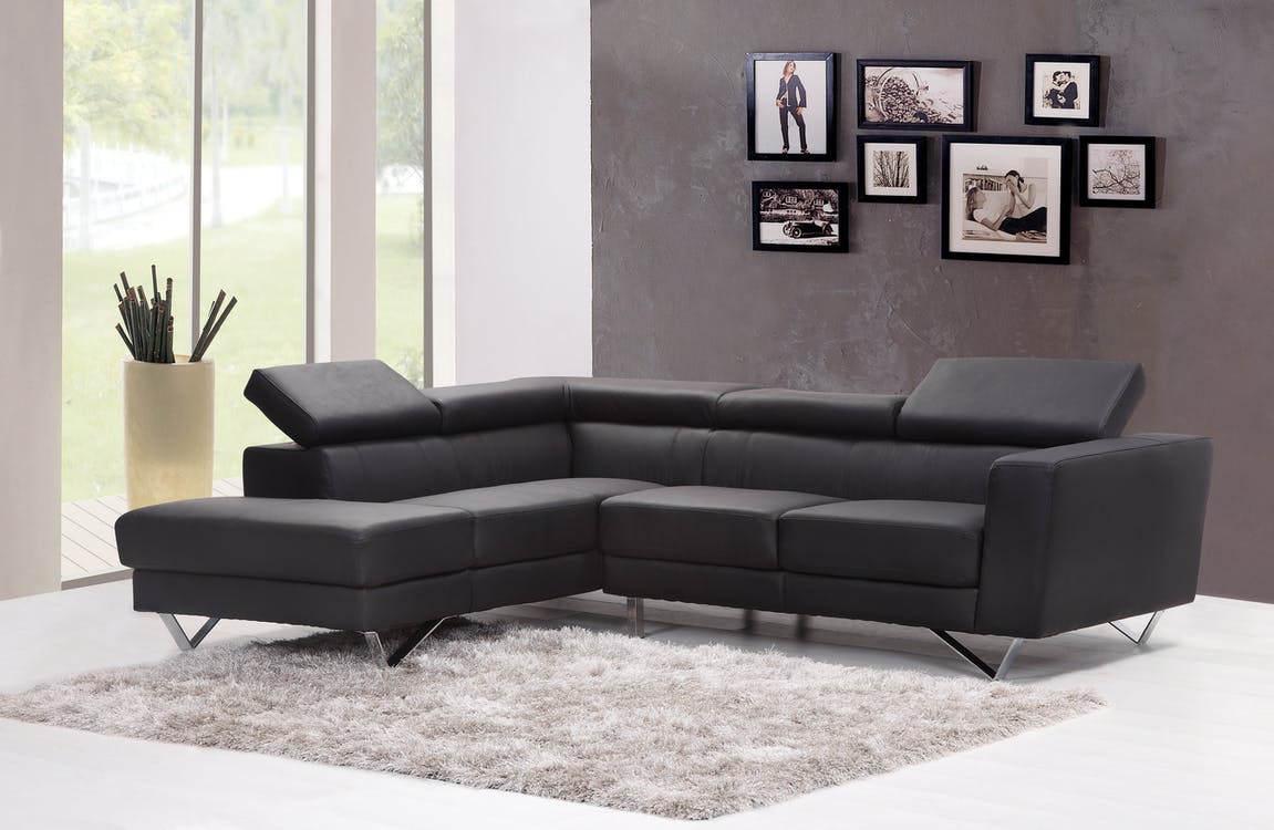 Black Fabric Sectional Sofa Near Glass Window