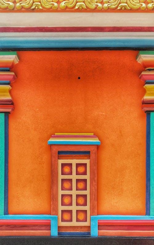 Orange, Blue, and White Concrete Building