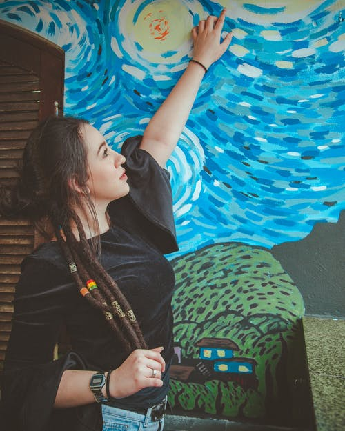 Woman Touching a Wall Painting