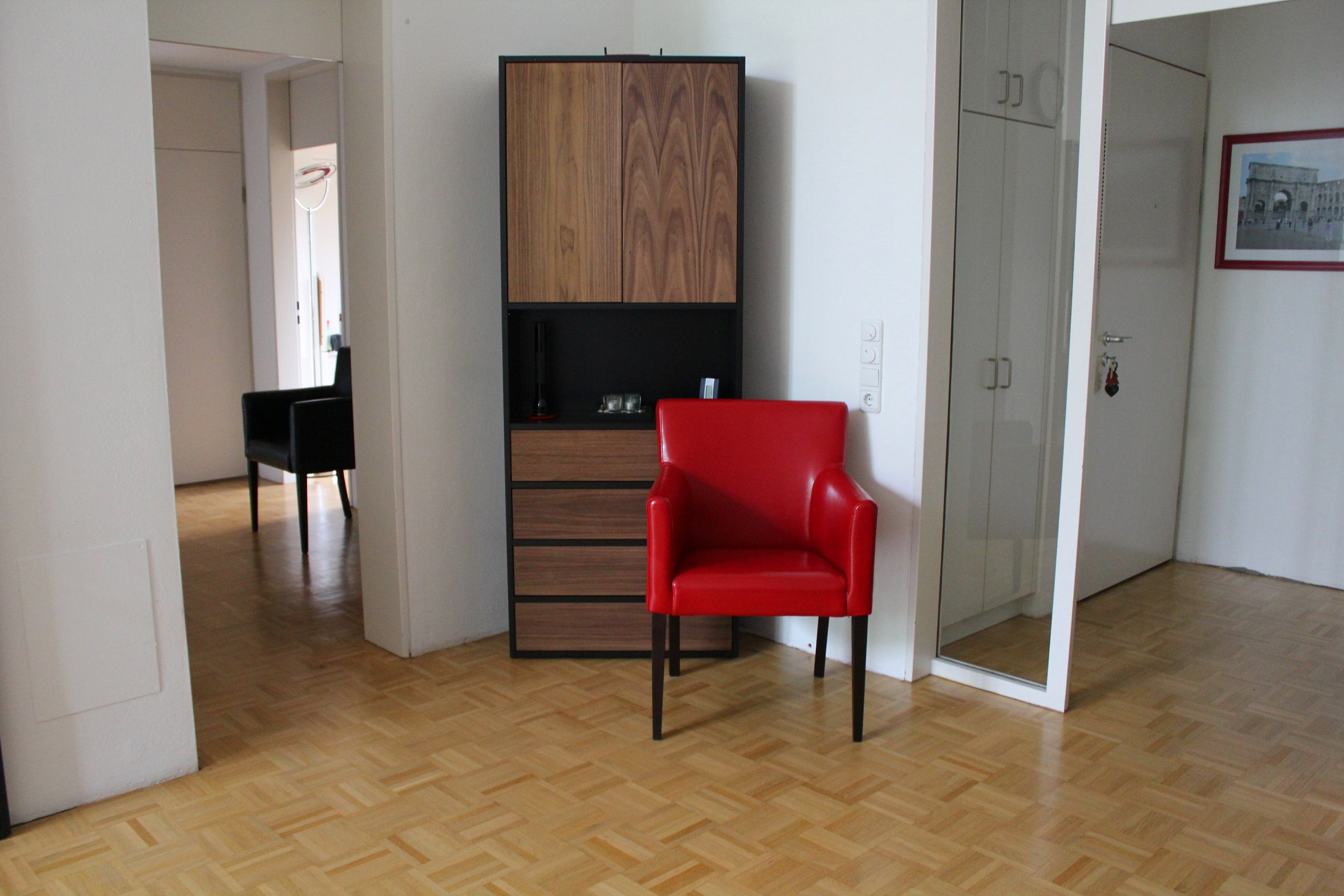 Red Leather Armchair Near Cabinet