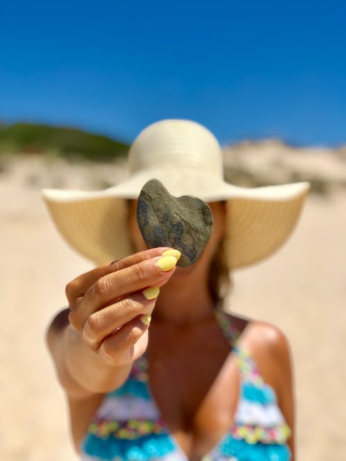 Woman Holding Smooth Stone