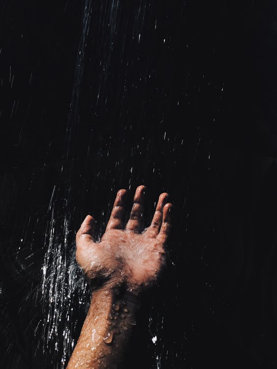 Person's Left Hand Catching Water
