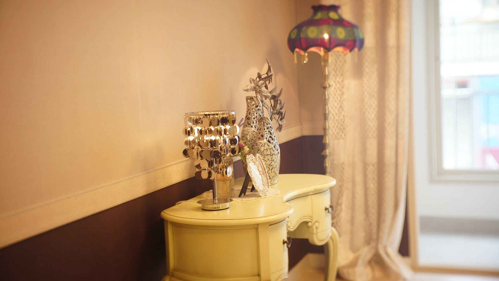 Silver Table Decor on White Side Table