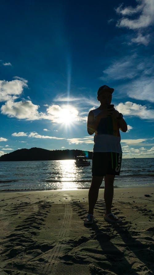 Free stock photo of Asian, backlight, beach, boy