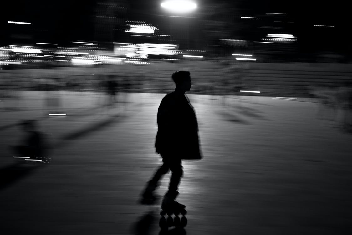 Monochrome Photo of Person Roller Skating