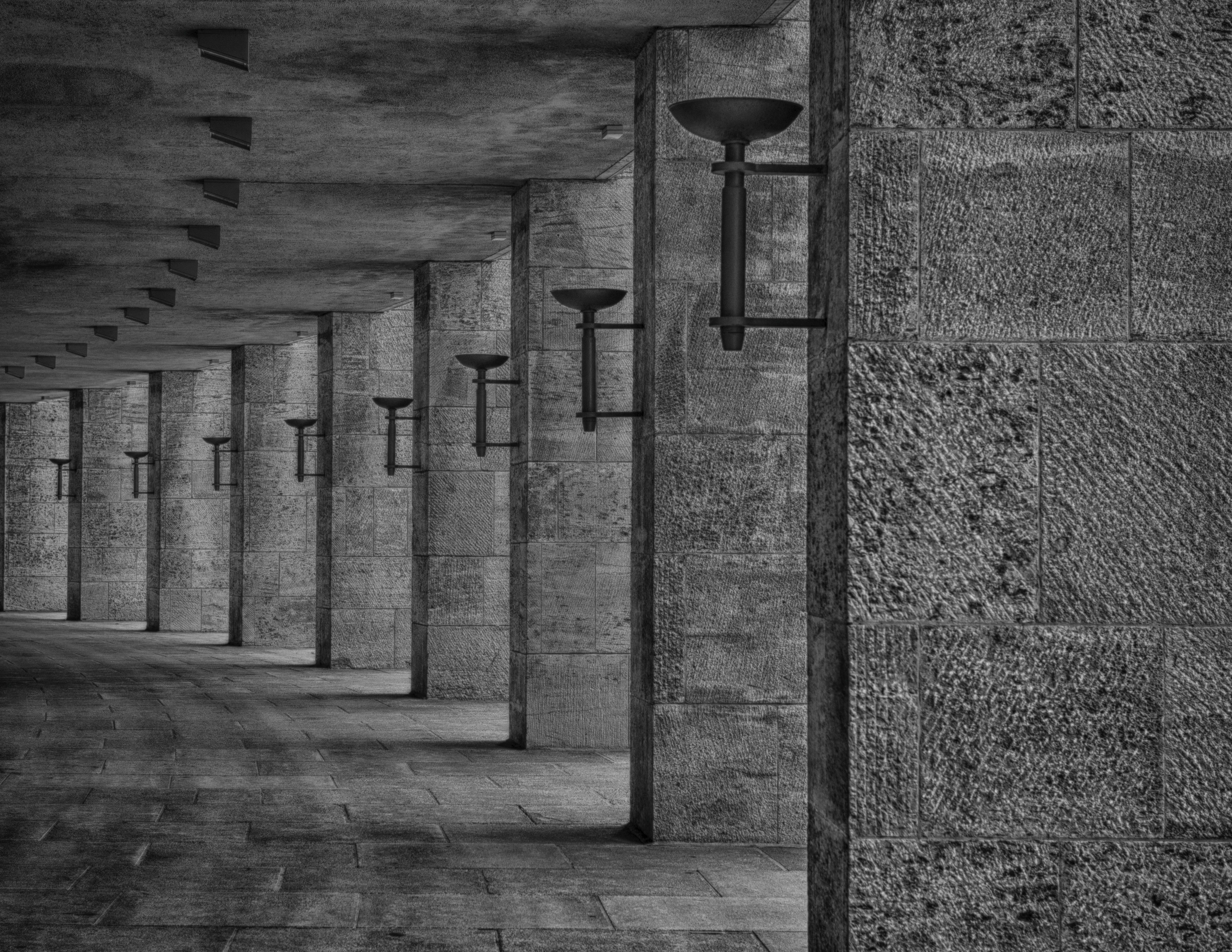 Grayscale Photography of Concrete Column With Torch