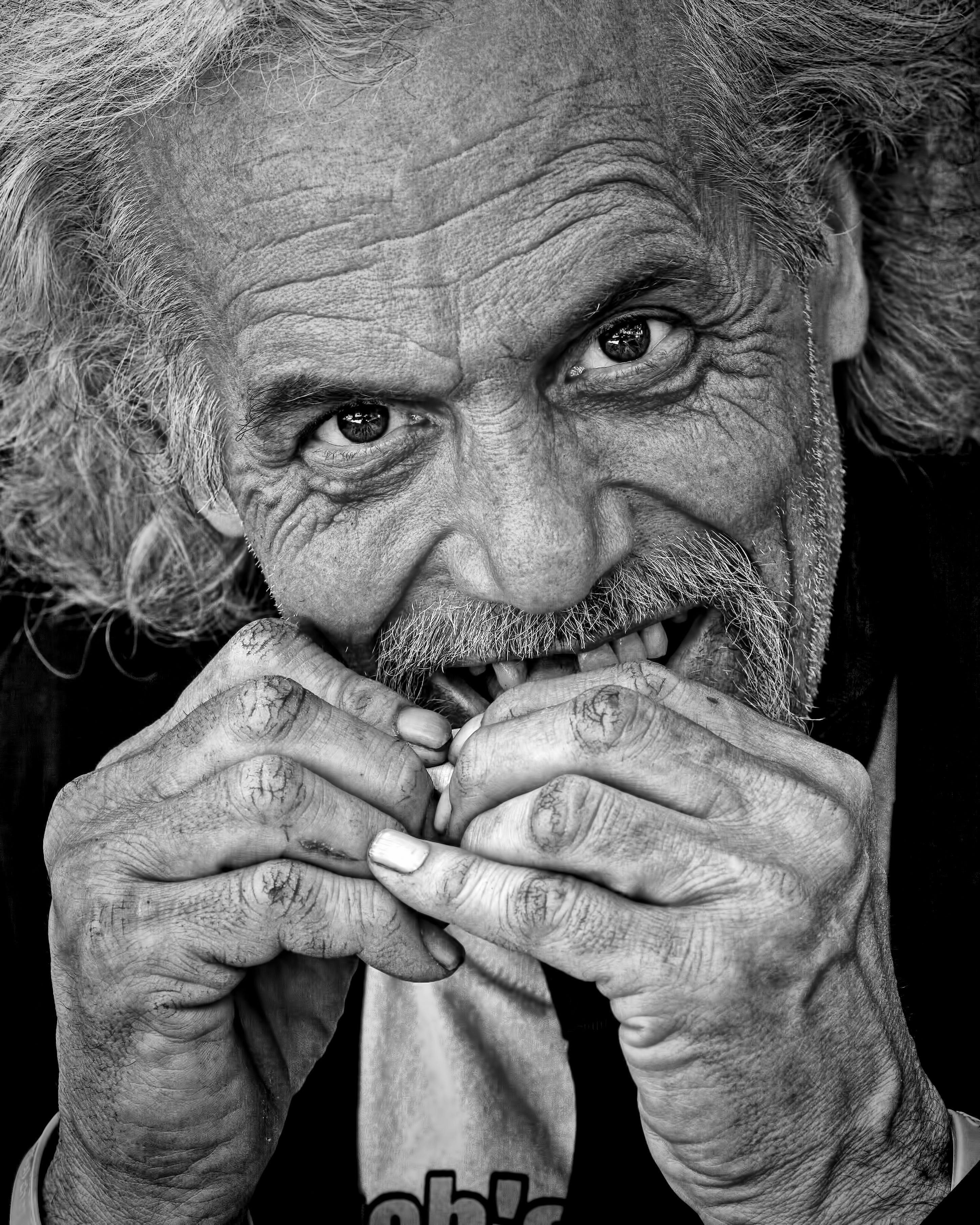 Grayscale Photography of Man Eating