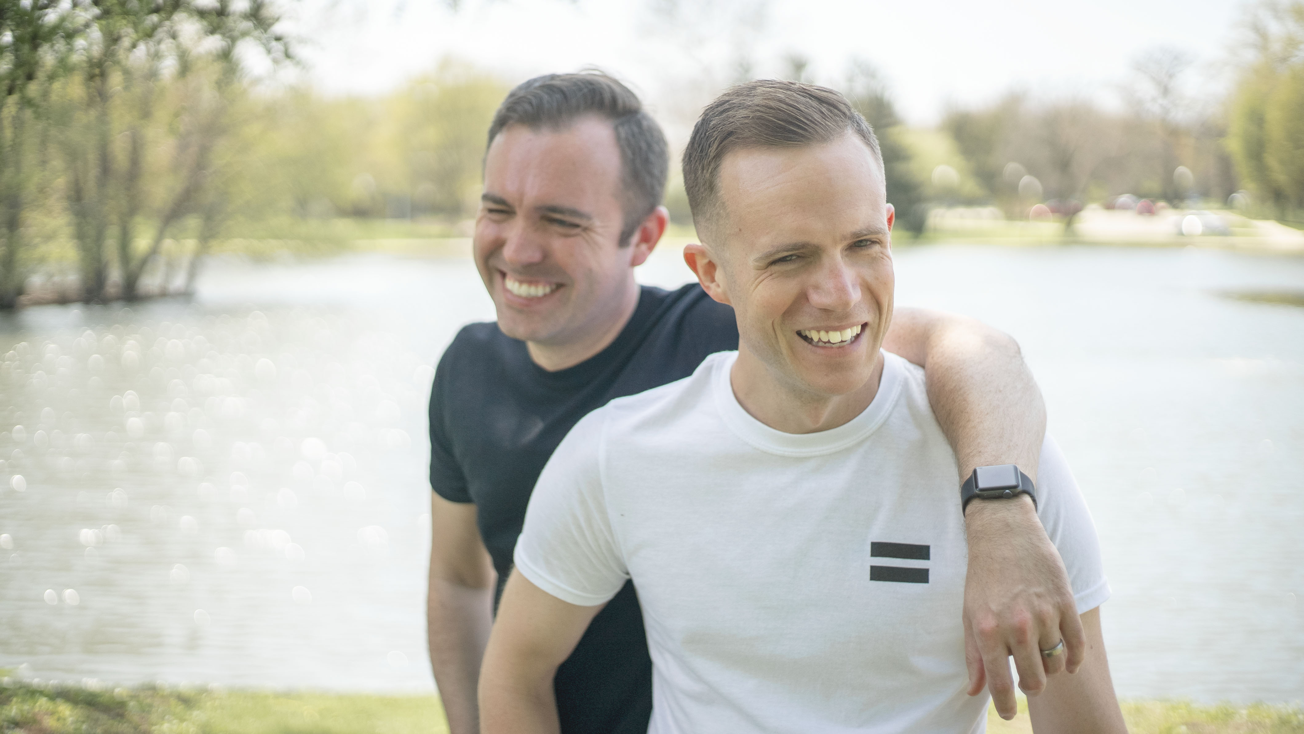 Close-up Photo of Two Friends Standing and Laughing Together
