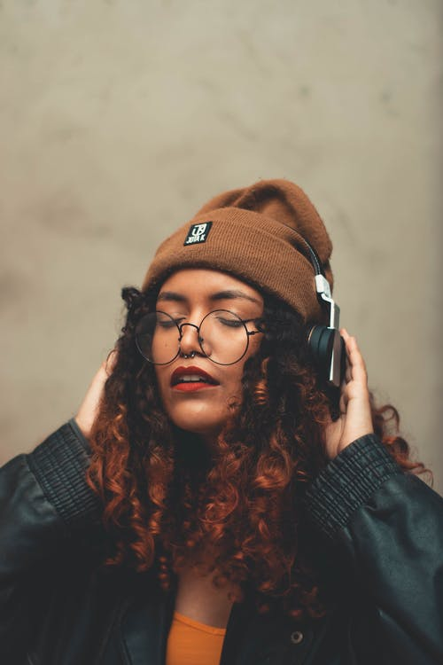 Photo Of Woman Wearing Headphones