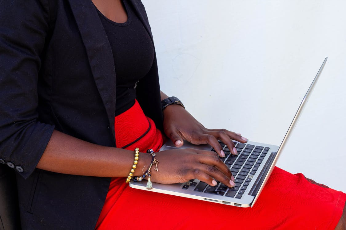 Photo of Woman Using a Laptop