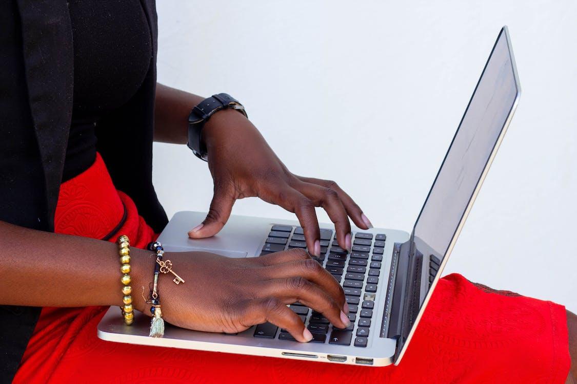 hands on laptop keyboard