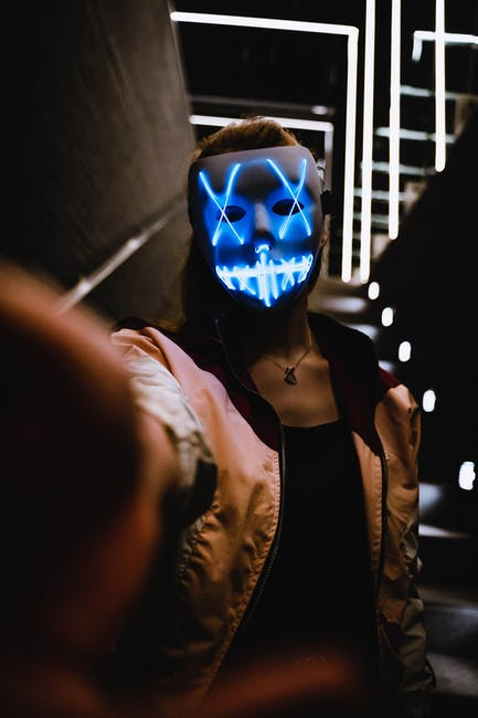 Person wearing light up mask