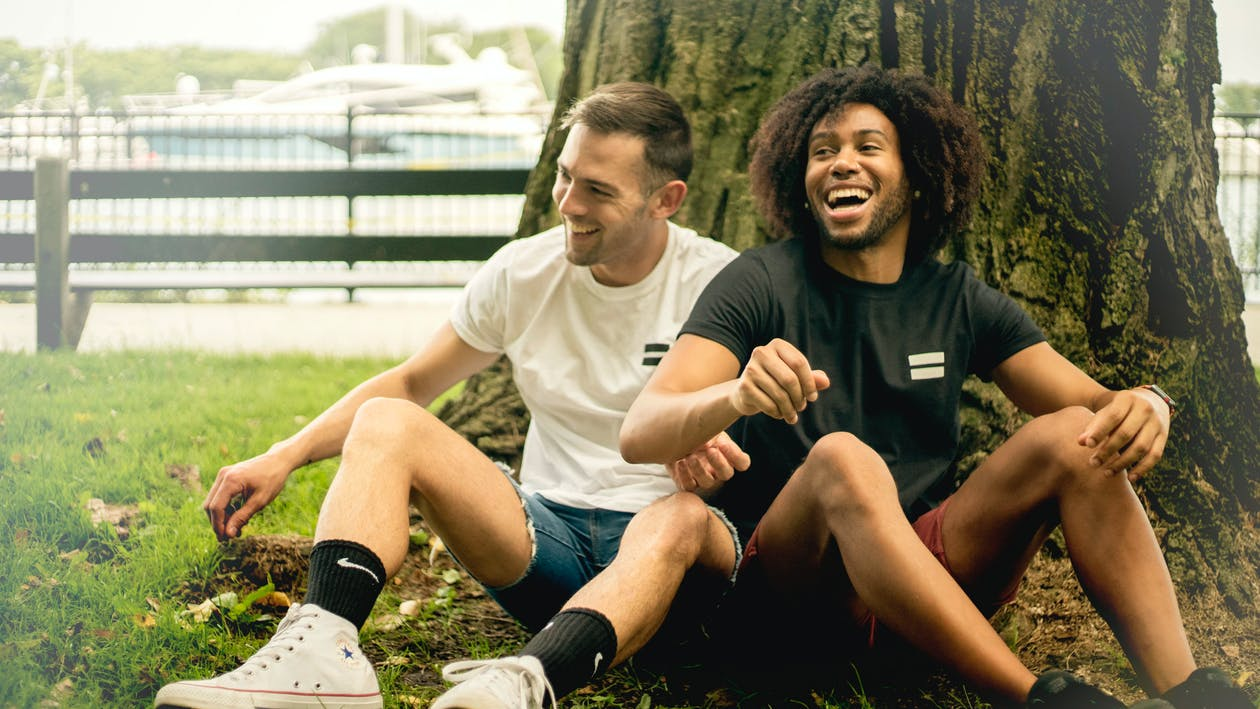 Smiling Men Sitting Beside Tree