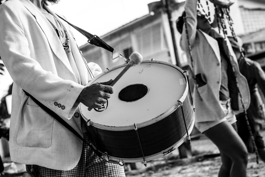 Person Holding Drum