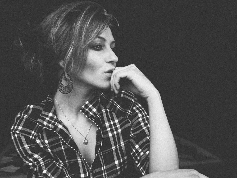 Grayscale Photo of Woman Wearing Flannel