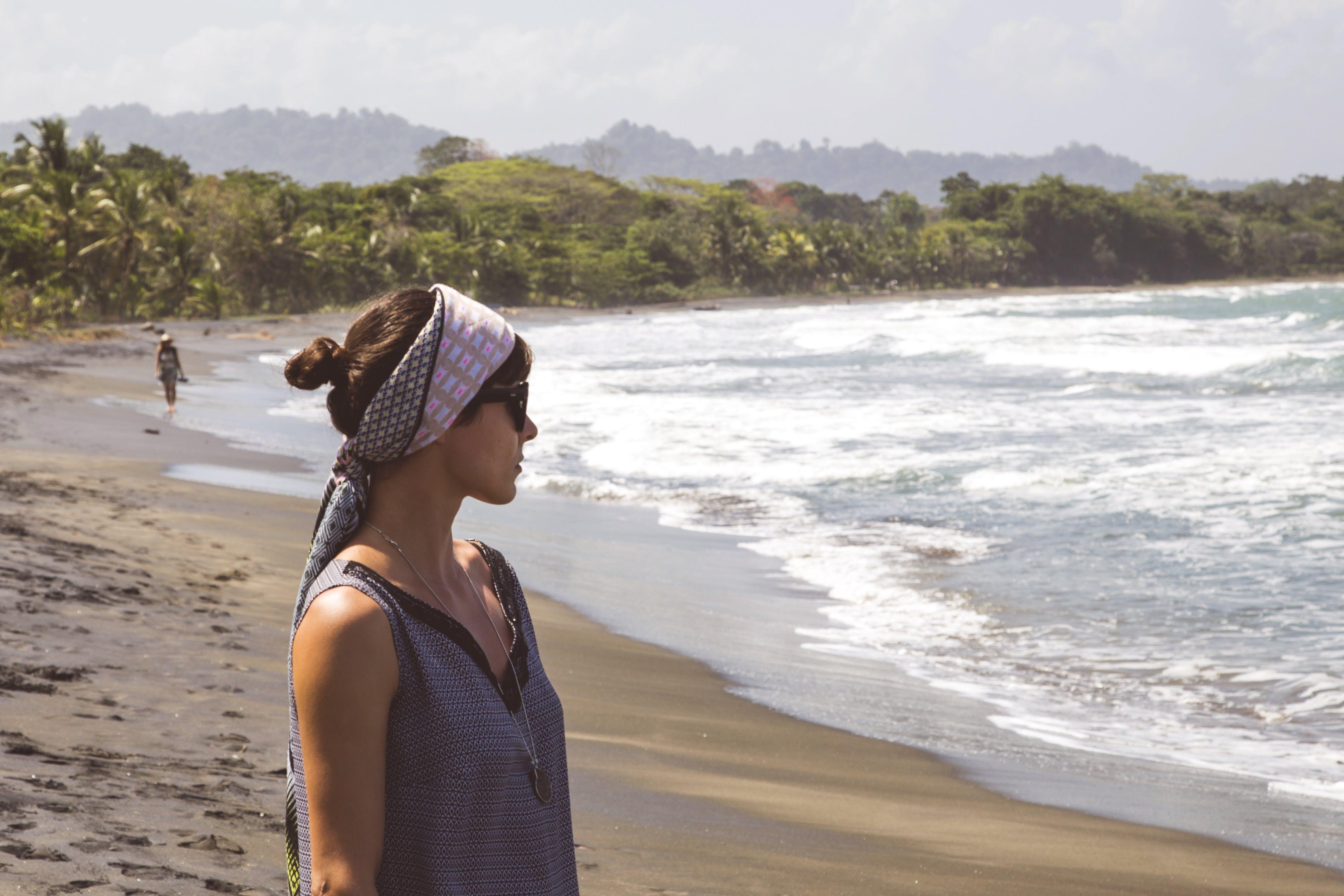 Woman Staring the Ocean