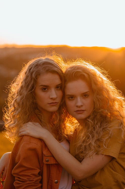 Two Women With Curly Hair