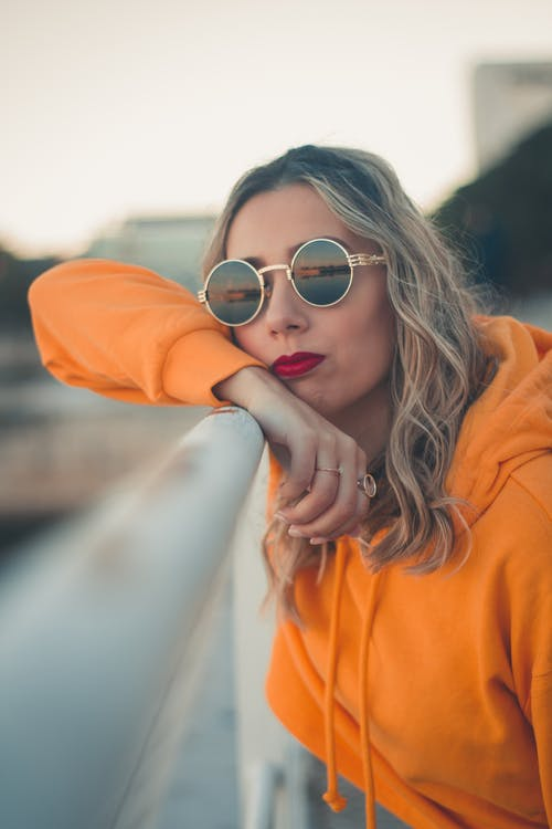 Photo Of Woman Wearing Orange Hoodie