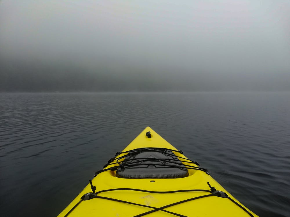 Photo of Kayak on Body of Water