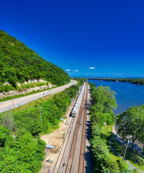 Train Railway Beside Body of Water