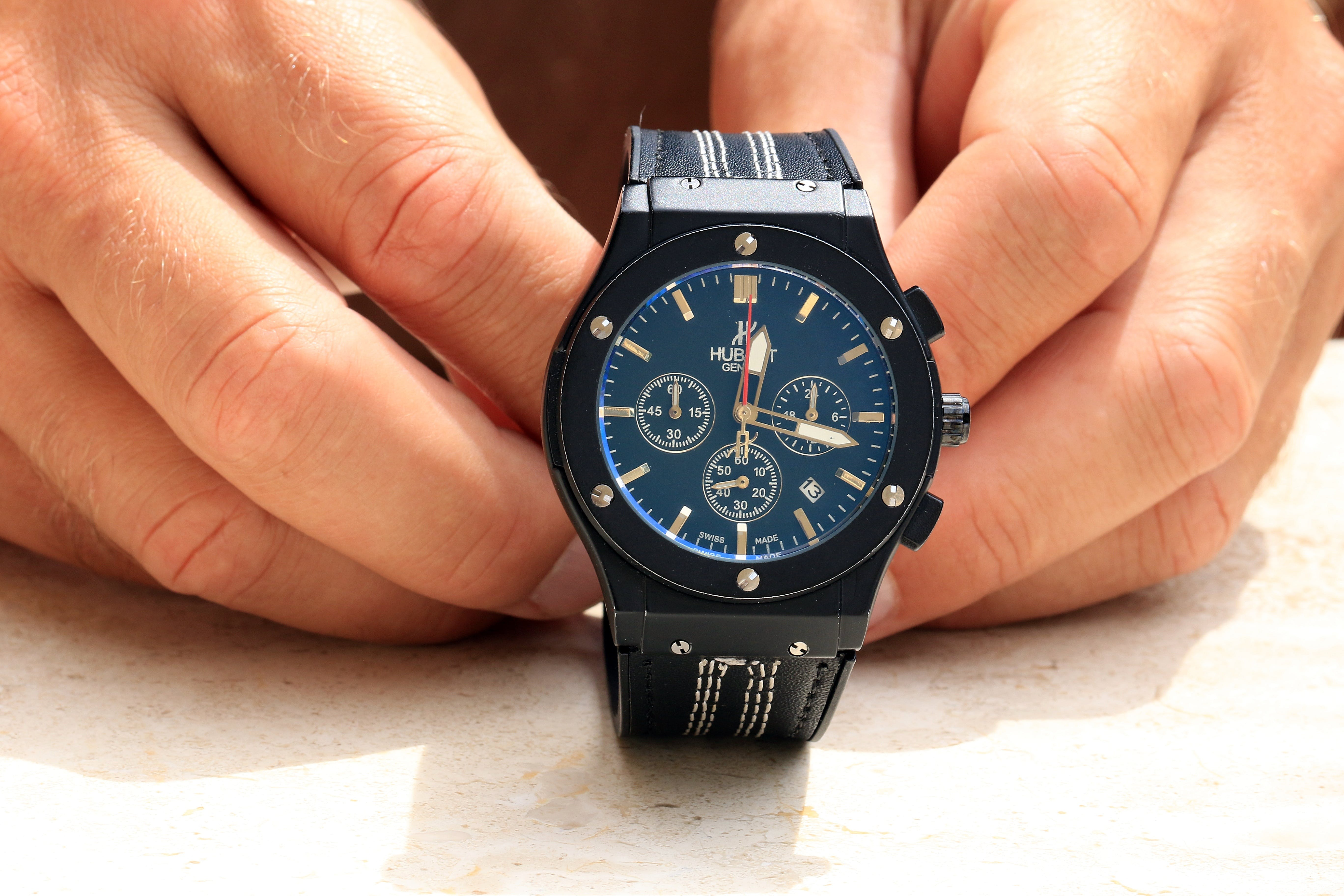 Person Holding Black Chronograph Watch