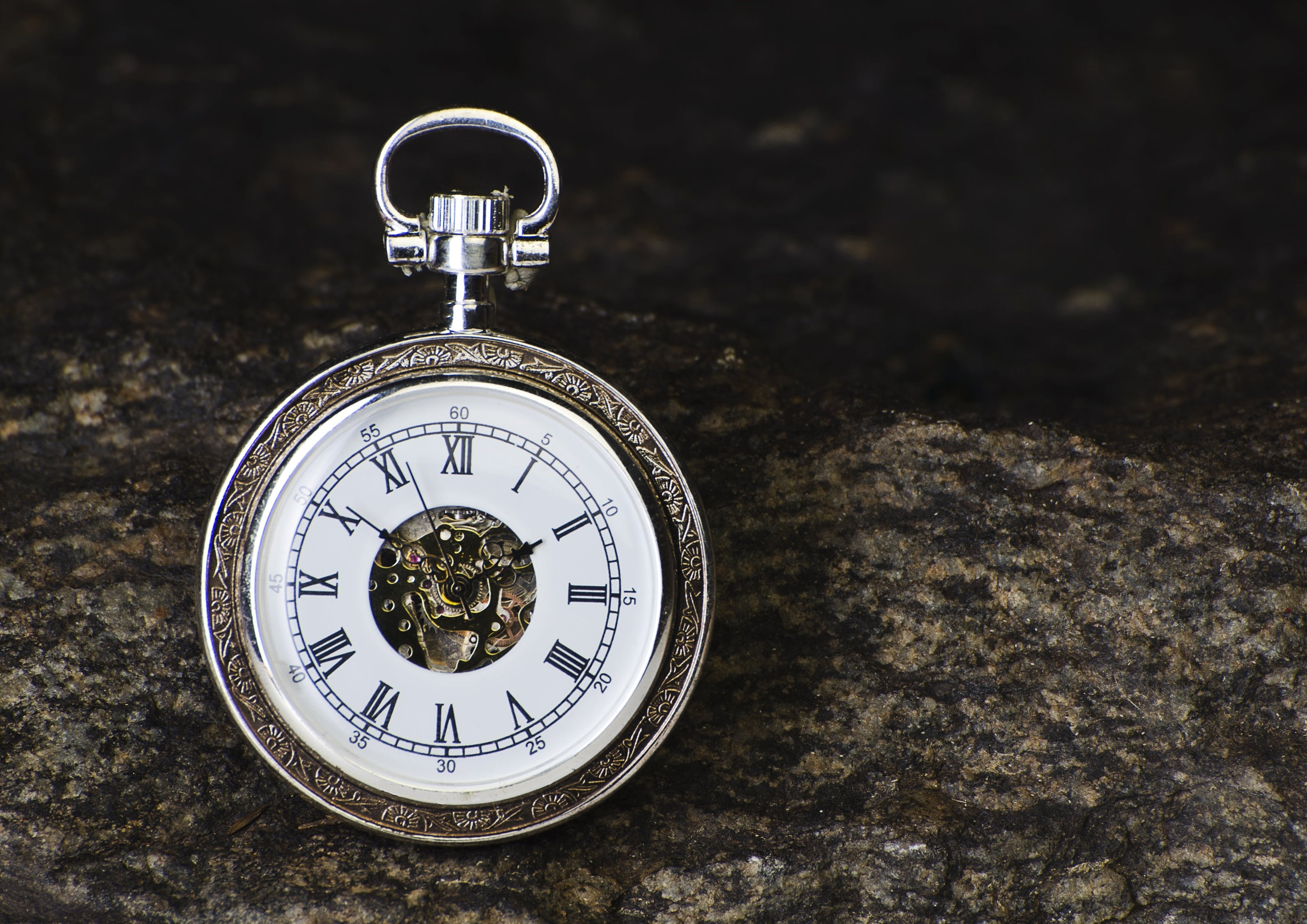 Round Gray Pocket Watch Reading 1:56 Time