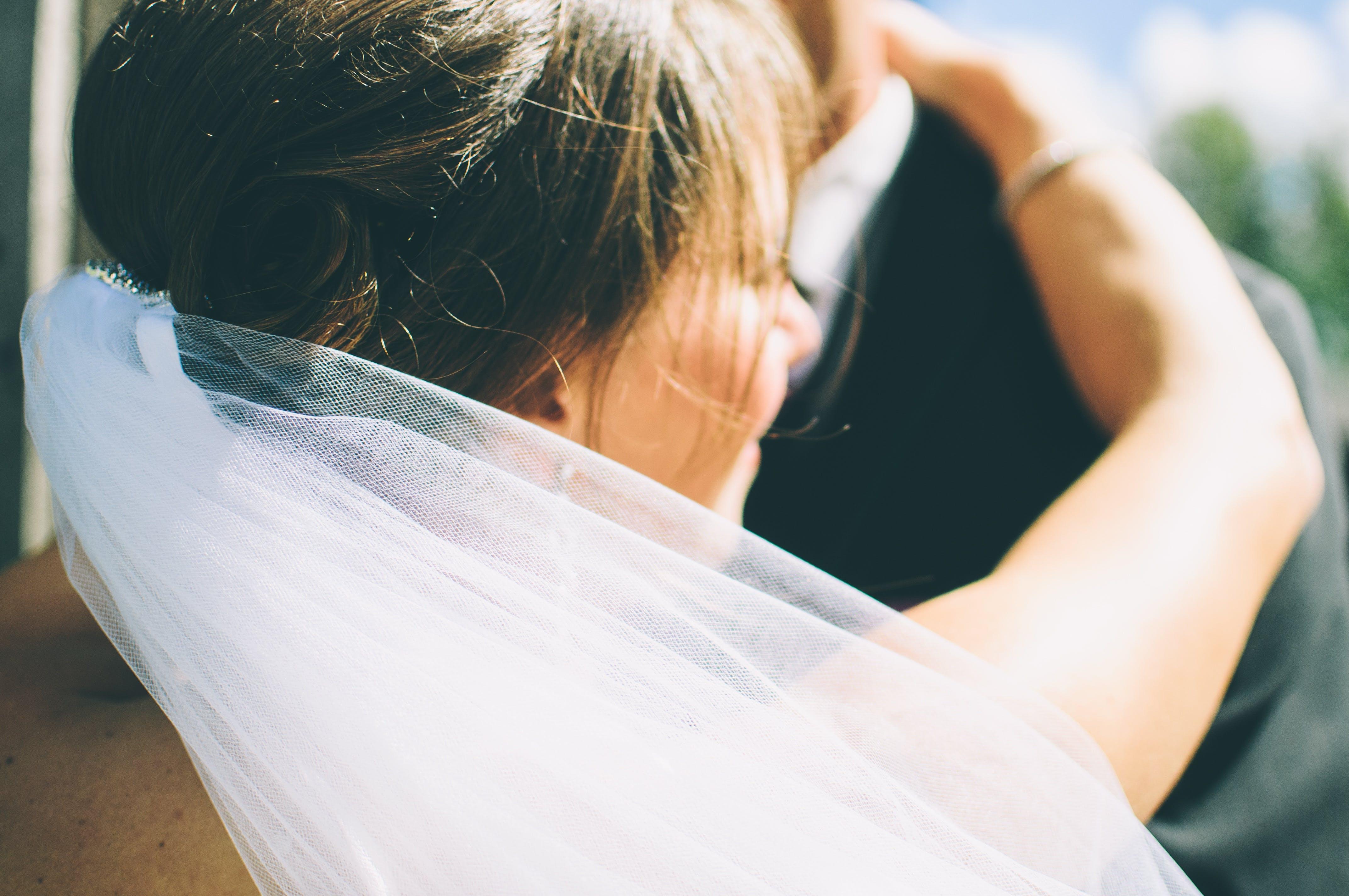 Bride Dancing With Groom in Black Suit Jacket