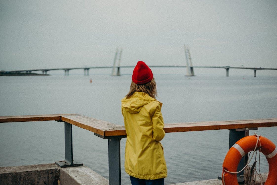 Women Wearing Yellow Jacket