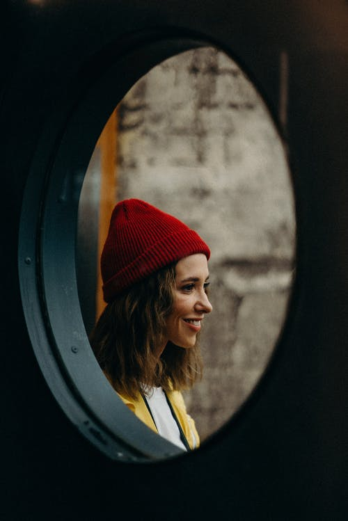 Smiling Woman Wearing Red Knit Cap
