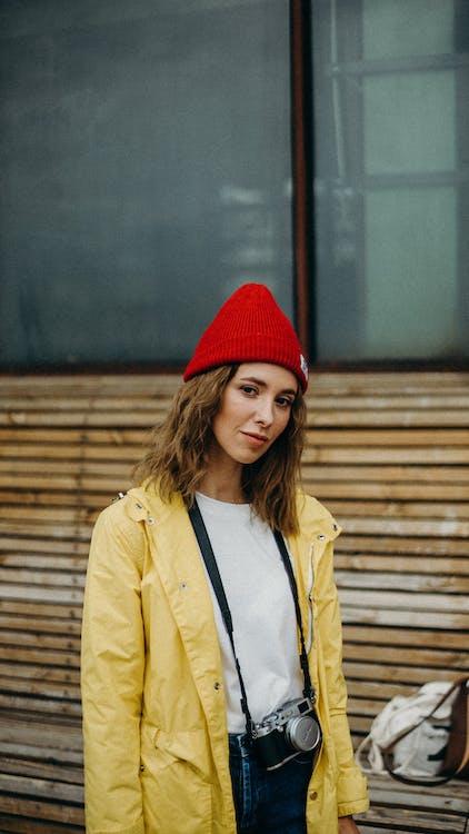 Woman in Red Bonnet Wearing Camera