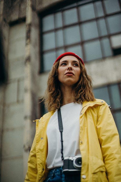 Woman Wearing Yellow Jacket
